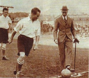 The future King George VI kicks off for the Corinthians against Spurs in 1921.