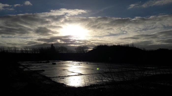 Low winter sun over abandoned landscape