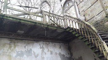 Dilapidated staircase and balcony at Crawford Priory