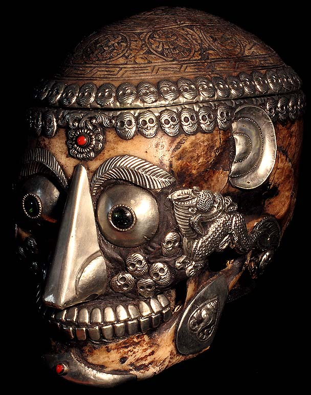 A kapala - a human skull cup carved and decorated with precious metals and jewels